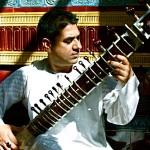 Mohamed Assani on sitar.